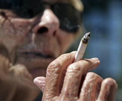 Helen Heinlo smokes outside of a coffee shop in Belmont, Calif. (AP Photo/Paul Sakuma, File)