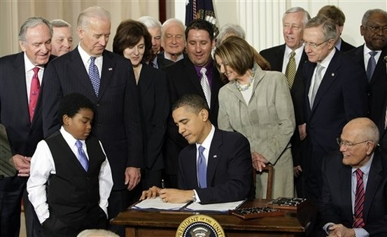On March 23, 2010 President Barack Obama signs PPACA. (AP/J. Scott Applewhite)