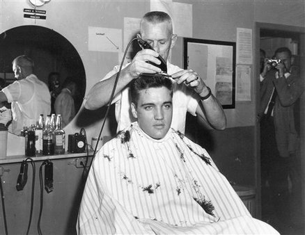 Elvis gets an Army cut. AP Photo.