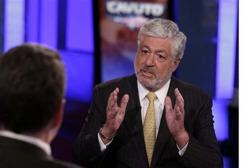 AIG CEO Robert Benmosche, right, is interviewed by Neil Cavuto in New York, March 19, 2013. (AP /Richard Drew)