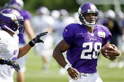 ESPN's No. 1 fantasy football pick this year? Vikings running back Adrian Peterson. (AP Photo/Charlie Neibergall)