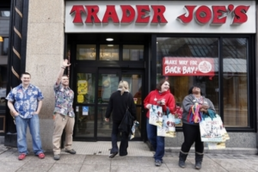 An April 2013 photo of Trader Joe's employees during happier times (AP Photo/Michael Dwyer)