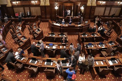 The floor of the Illinois State Senate, where lawmakers are now debating a plan to fix the state's pension crisis. AP Photo/Seth Perlman