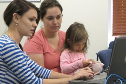 An Illinois assister helps a woman explore the exchange system. (AP photo/David Mercer)