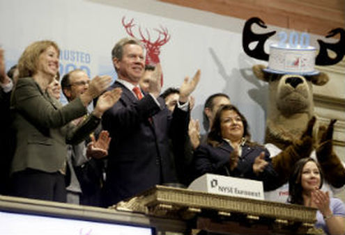 Liam McGee, Chairman of Hartford Financial Services, center, opening bell ceremonies of New York Stock Exchange in 2010. (AP Photo/Richard Drew)