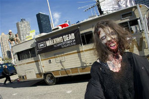 A wandering zombie at NYC-Comic-Con (Photo by Charles Sykes/Invision for AMC/AP Images)