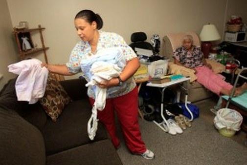 Taura Tate provides long-term care in a home in Euclid, Ohio. (AP photo/Tony Dejak)