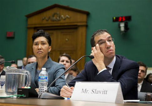 Cheryl Campbell, senior vice president of CGI listens at left as Andy Slavitt, representing QSSI's parent company, testifies on Capitol Hill. (AP Photo/ Evan Vucci)