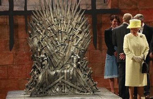 We can only wonder if Queen Elizabeth II wanted to sit on the coveted Iron Throne. (AP/Peter Morrison)