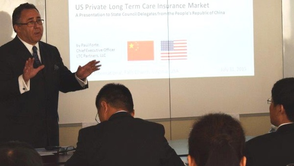 Paul Forte tells visitors from China about the U.S. private long-term care insurance market. (LTC Partners photo)