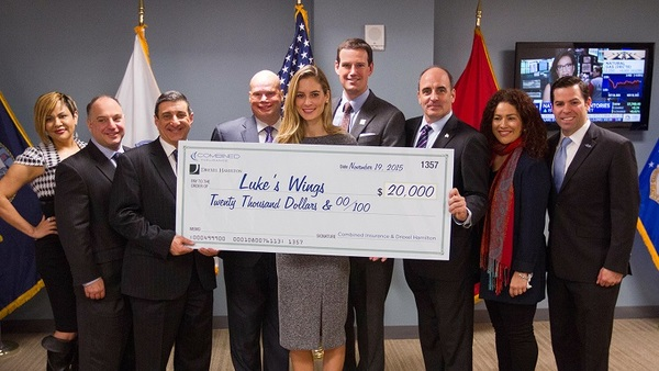 Combined Insurance helped Drexel Hamilton raise $20,000 for transportation for relatives of wounded service members.