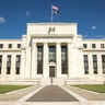 Fed scales back rate-rise forecasts as global outlook weakens