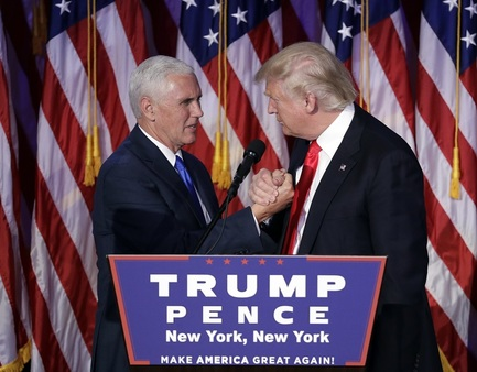 President-elect Donald Trump shakes hands with Vice President-elect Mike Pence as he gives his acceptance speech during his election night rally in New York. (AP Photo/John Locher)