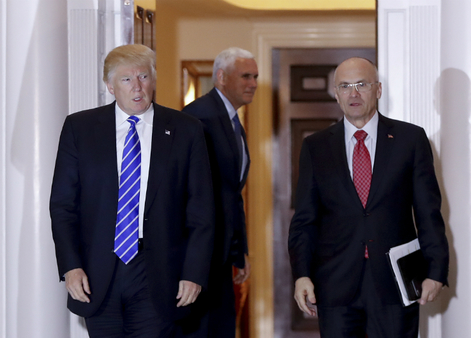 Andrew Puzder (right), Trump's expected choice to head the Labor Department, is an outspoken critic of overregulation. (AP Photo/Carolyn Kaster)
