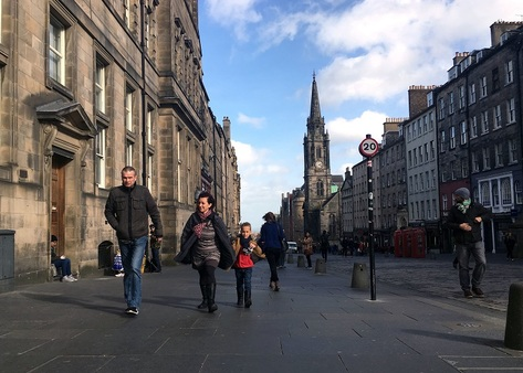 People who support the power of the Scottish Parliament, but were squeamish about breaking up the three-centuries-old U.K. are among the key groups that could now swing the vote for independence. Here, a family walks down a street in Edinburgh. ((AP Photo/Vitnija Saldava))