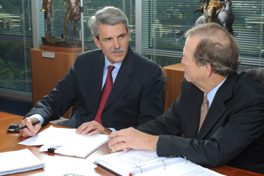 CEO Paul Reilly, left, and Chairman Tom James of Raymond James Financial.