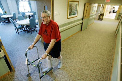 Resident of nursing home walks down hallway. (Photo: AP)