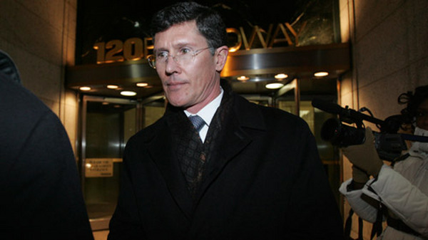 John Thain leaving the New York attorney general's office in 2009. (Photo: AP)