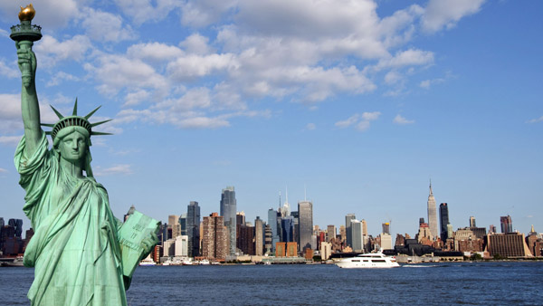 The Statue of Liberty and the New York skyline.
