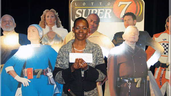 Sharon Tirabassi holding her lottery check.