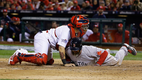 Boston Red Sox David Ross is tagged out by St. Louis Cardinals catcher Yadier Molina in the World Series. (Photo: AP)