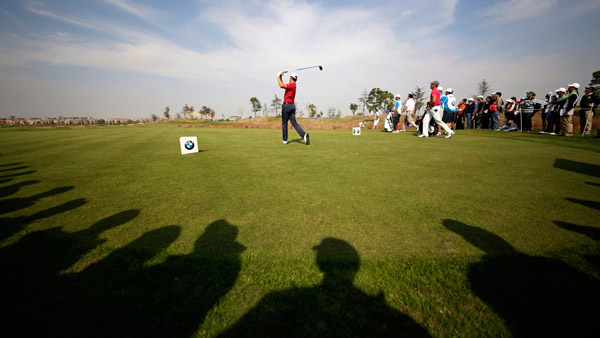Luke Guthrie of the U.S. tees off at the BMW Masters golf tournament in Shanghai, China. (Photo: AP)