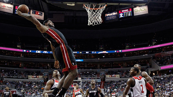 Miami Heat LeBron James goes to the basket as Washington Wizards in preseason NBA game. (Photo: AP)