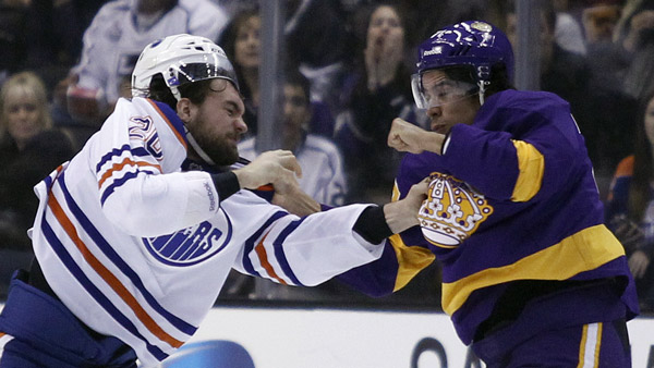Edmonton Oilers Luke Gazdic, left, scuffles with Los Angeles Kings Jordan Nolan. (Photo: AP)