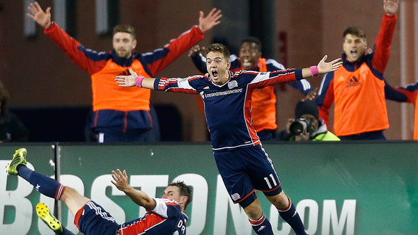 New England Revolution's Kelyn Rowe (11) calls for a penalty against the Columbus Crew. (Photo: AP)