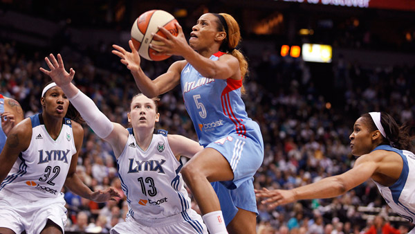 Atlanta Dream guard Jasmine Thomas (5) driving to the basket against Minnesota Lynx during the WNBA Finals. (Photo: AP)