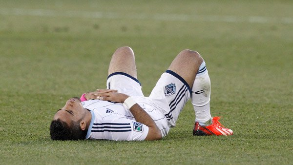 This Major League Soccer player resting at the end of a game better hope he's saving for retirement. (Photo: AP)