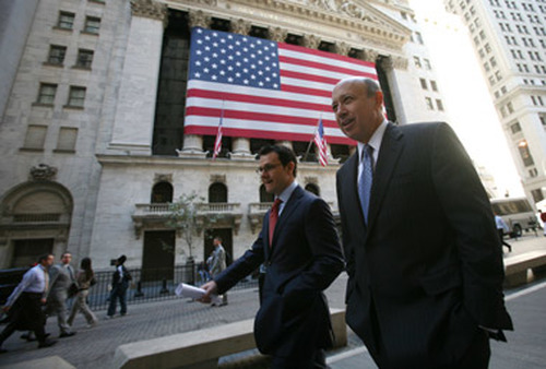 Goldman CEO Lloyd Blankfein, right, in front of the NYSE. (Photo: AP)