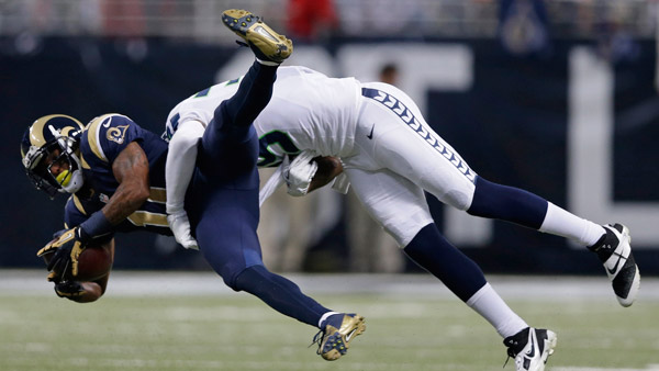 St. Louis Rams Tavon Austin tackled by Seattle Seahawks Brandon Browner. (Photo:AP)