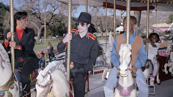 Michael Jackson rides the merry-go-round at his Neverland Ranch in 1994. (Photo: AP)