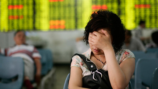 A Chinese investor reacting to stock board in Shanghai. (Photo: AP)