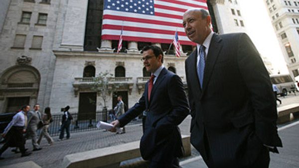 Lloyd Blankfein, right, CEO of Goldman Sachs walking past the NYSE. (Photo: AP)
