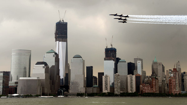 Jets flying in formation past Lower Manhattan. (Photo: AP)