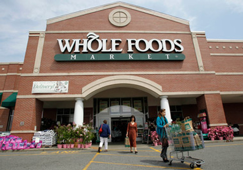 Whole Foods' maximum 401(k) contribution is $152 a year, but the store touts its other employee benefits. (Photo: AP)