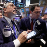 Dow Erases 2014 Gain Amid Global Selloff as Exxon Tumbles