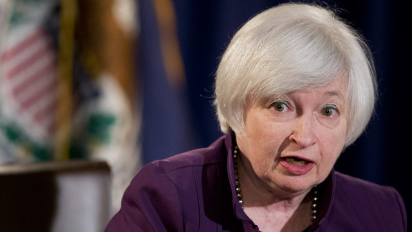If Janet Yellen of the Fed raises rates, don't expect the good ol' high-rate days for a long time. (Photo: AP)