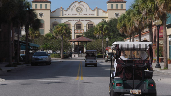 Residents ride in their golf carts along Main St. in The Villages. (Photo: AP)