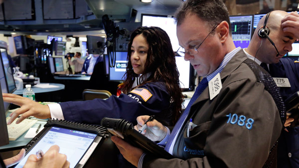 Traders on the floor of the New York Stock Exchange. (Photo: AP)