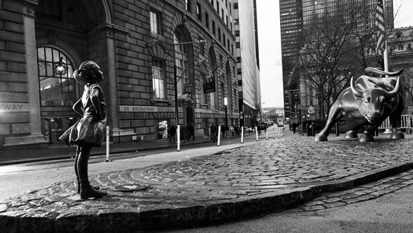 """The """"SHE"""" statue placed near the Charging Bull statue in the Financial District on Broadway. (Photo: Federica Valabrega)"""