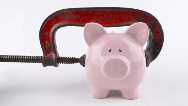 Piggy bank in a vise (Photo: Thinkstock)