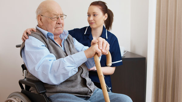 Older man with caregiver (Photo: Shutterstock)