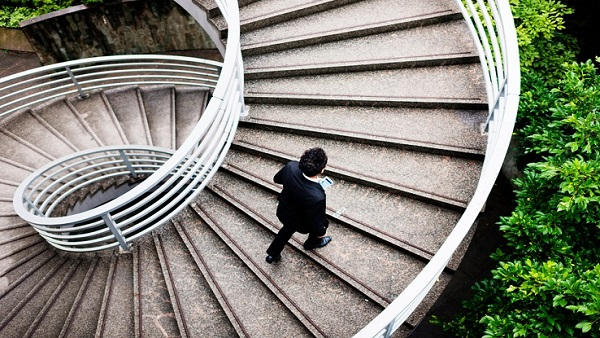 A man walking up steps (Photo: iStock)