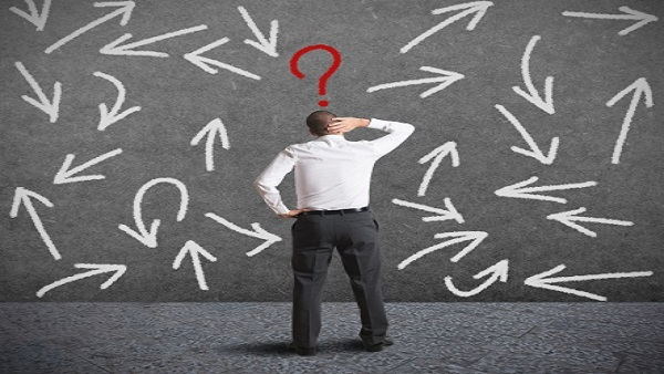 Confused man looking at a confusing flowchart (Image: Thinkstock)