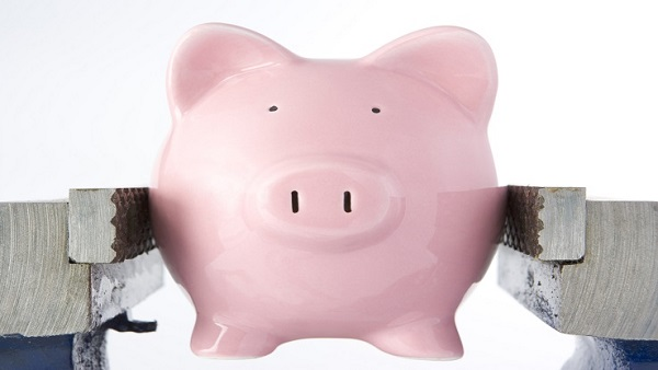 Piggy bank in a vise (Image: Thinkstock)