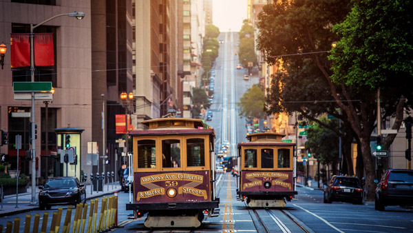 Cable Cars riding down the streets of San Francisco.