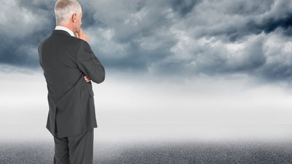 Man looking at a storm (Photo: Thinkstock)